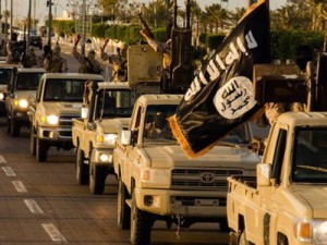"""An image made available by propaganda Islamist media outlet Welayat Tarablos on February 18, 2015, allegedly shows members of the Islamic State (IS) militant group parading in a street in Libya's coastal city of Sirte, which lies 500 kilometres (310 miles) east of the capital, Tripoli. Egyptian F-16s bombed militant bases in the eastern Libyan city of Derna in mid-February after the Islamic State group in Libya released a gruesome video showing the beheadings of a group of Egyptian Coptic Christians who had gone to the North African country seeking work. AFP PHOTO / HO / WELAYAT TARABLOS === RESTRICTED TO EDITORIAL USE - MANDATORY CREDIT """"AFP PHOTO / HO / WELAYAT TARABLOS"""" - NO MARKETING NO ADVERTISING CAMPAIGNS - DISTRIBUTED AS A SERVICE TO CLIENTS FROM ALTERNATIVE SOURCES, AFP IS NOT RESPONSIBLE FOR ANY DIGITAL ALTERATIONS TO THE PICTURE'S EDITORIAL CONTENT, DATE AND LOCATION WHICH CANNOT BE INDEPENDENTLY VERIFIED ==="""